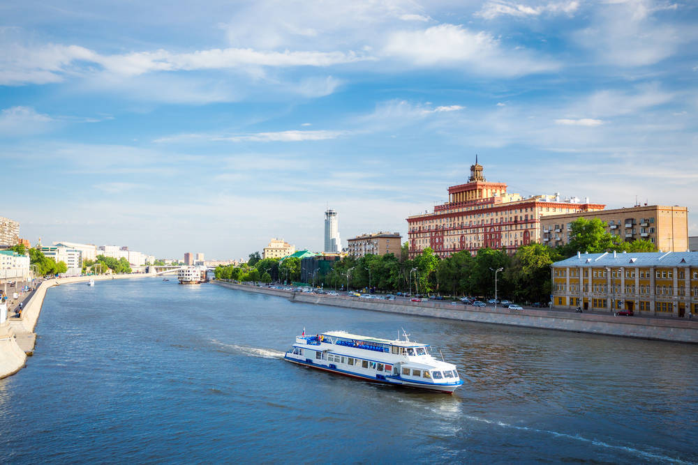Panoramic view of Moscow river with cruise boat in Moscow, Russia.
